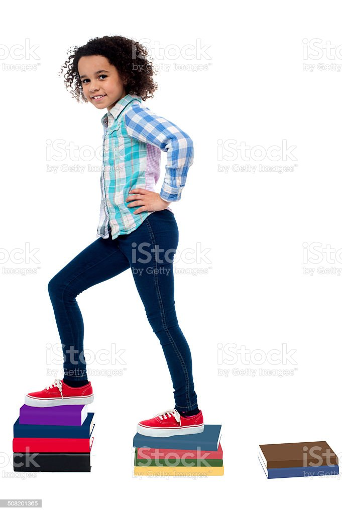 Successful child moving up in school grades stock photo