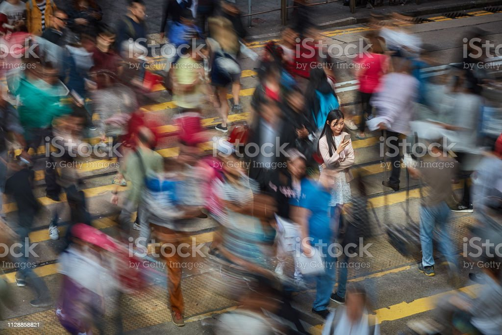Successful Chinese businesswoman in the street stock photo