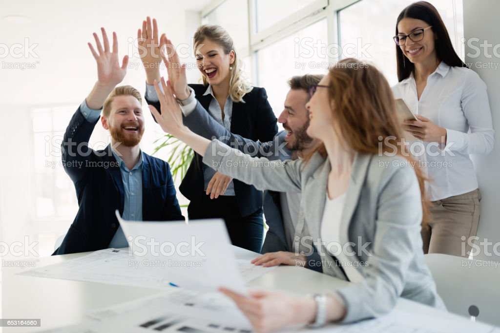 Successful company achieving goals with determined staff royalty-free stock photo