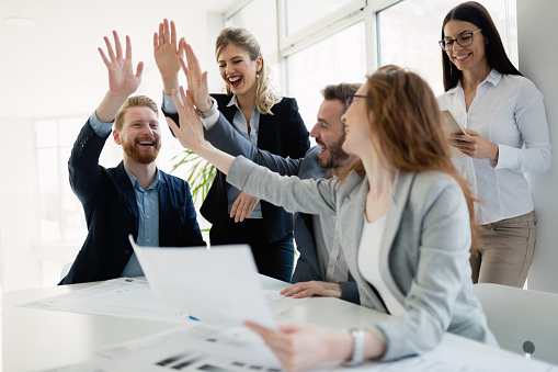 istock Successful company achieving goals with determined staff 653164560
