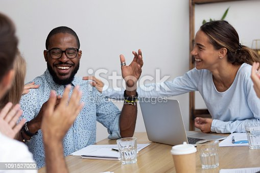istock Successful company member got promotion feels happy colleagues congratulate him 1091527020