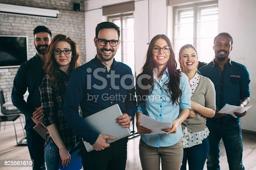 istock Successful company with happy workers 825561610