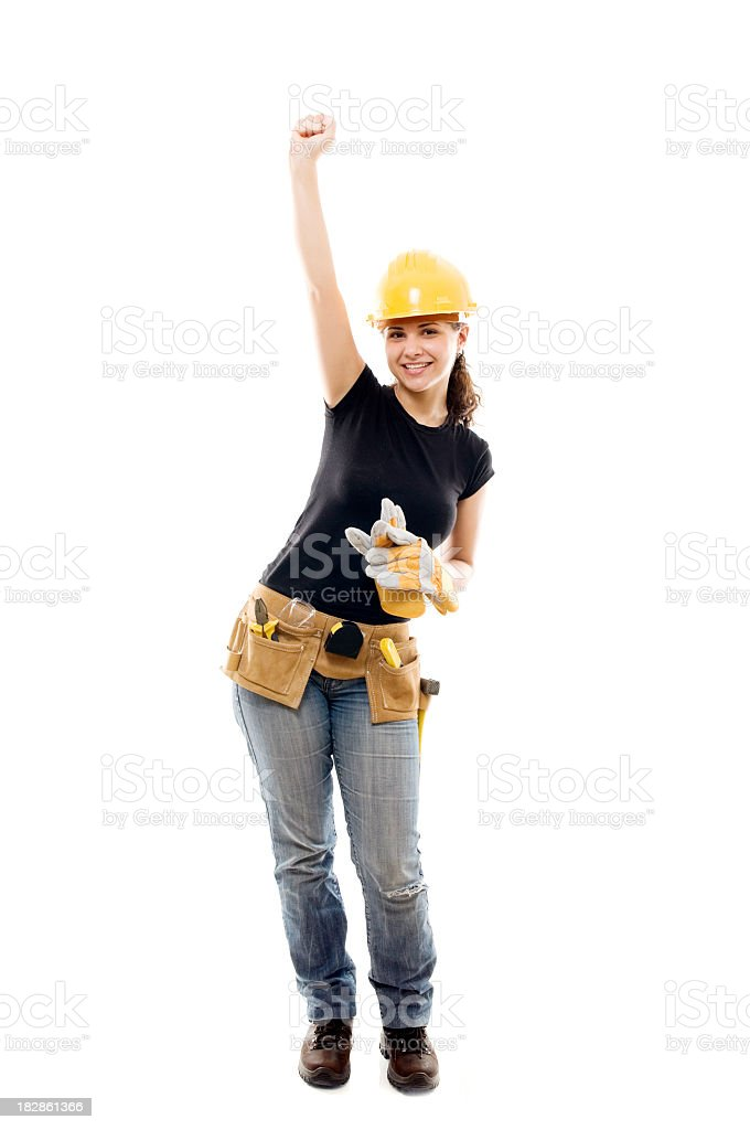 Successful constructor woman with arm raised, isolated on white royalty-free stock photo