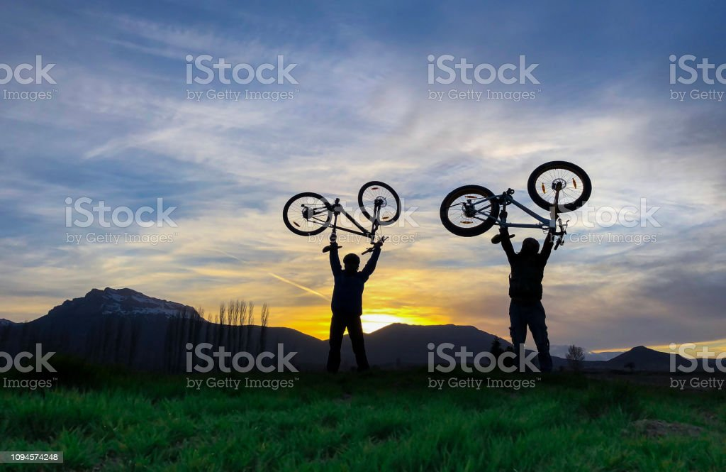 successful cyclist travelers stock photo