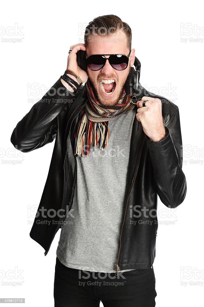 Successful DJ with raised fist stock photo