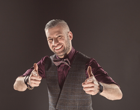 Successful Elegant Man Wearing Bow Tie And Tweed Vest Stock Photo - Download Image Now
