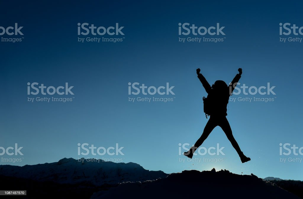 successful, energetic and enthusiastic female climber stock photo