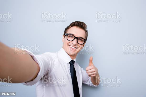 Successful excited young guy in glasses and formal wear is making picture id937327182?b=1&k=6&m=937327182&s=612x612&h=b t3o mda5z4d th9ojjeizykjtsofnaxao95hwdkym=