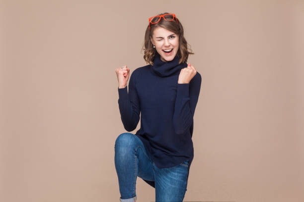 successful expressive woman rejoicing her victory - excited emoji stock photos and pictures