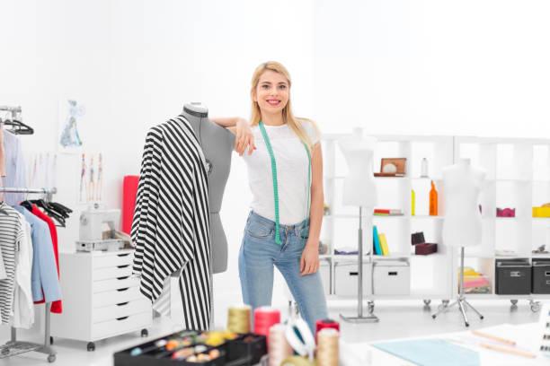 successful fashion designer in showroom stock photo