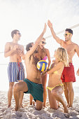 Successful friends after playing volleyball on the beach