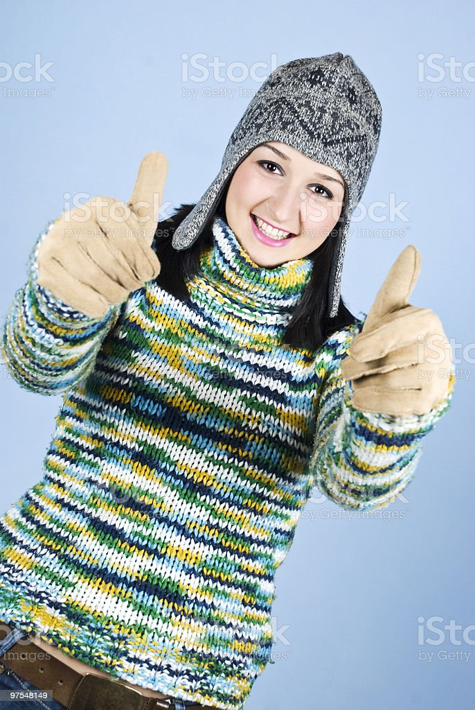 Successful girl in wool sweater give thumbs royalty-free stock photo