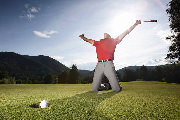 Successful golf player on green. stock photo