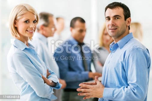 istock Successful group of businesspeople talking 174834613