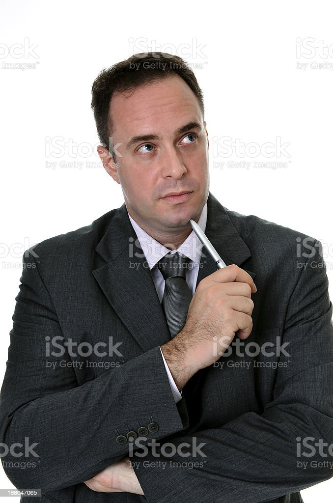 Successful handsome businessman thinking about investment on isolated white background royalty-free stock photo