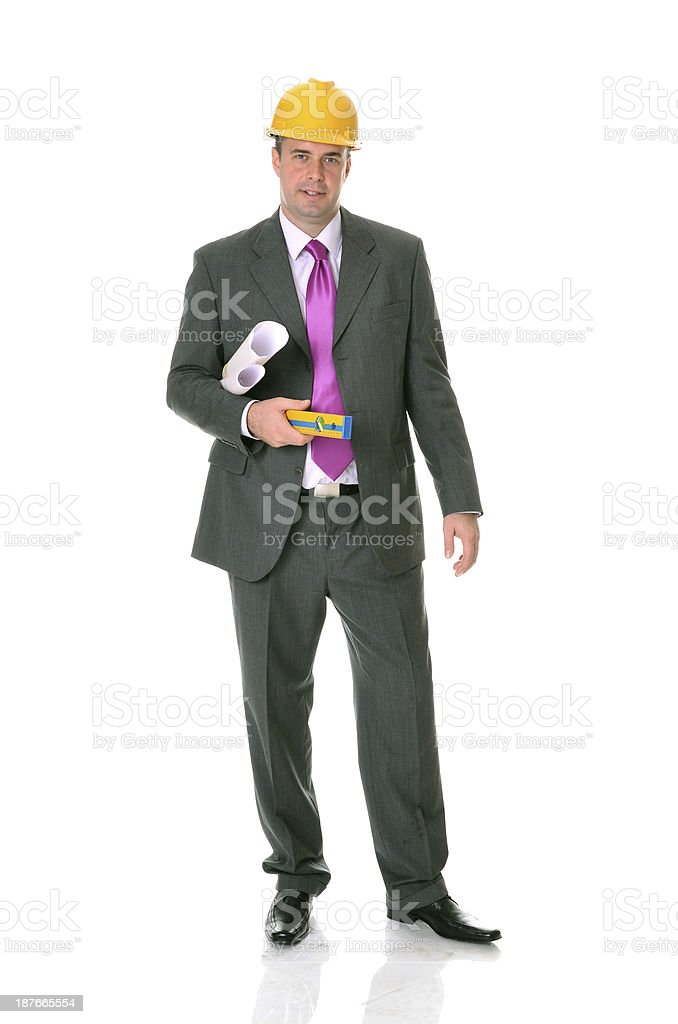 Successful handsome caucasian professional engineer with hardhat and blueprints royalty-free stock photo