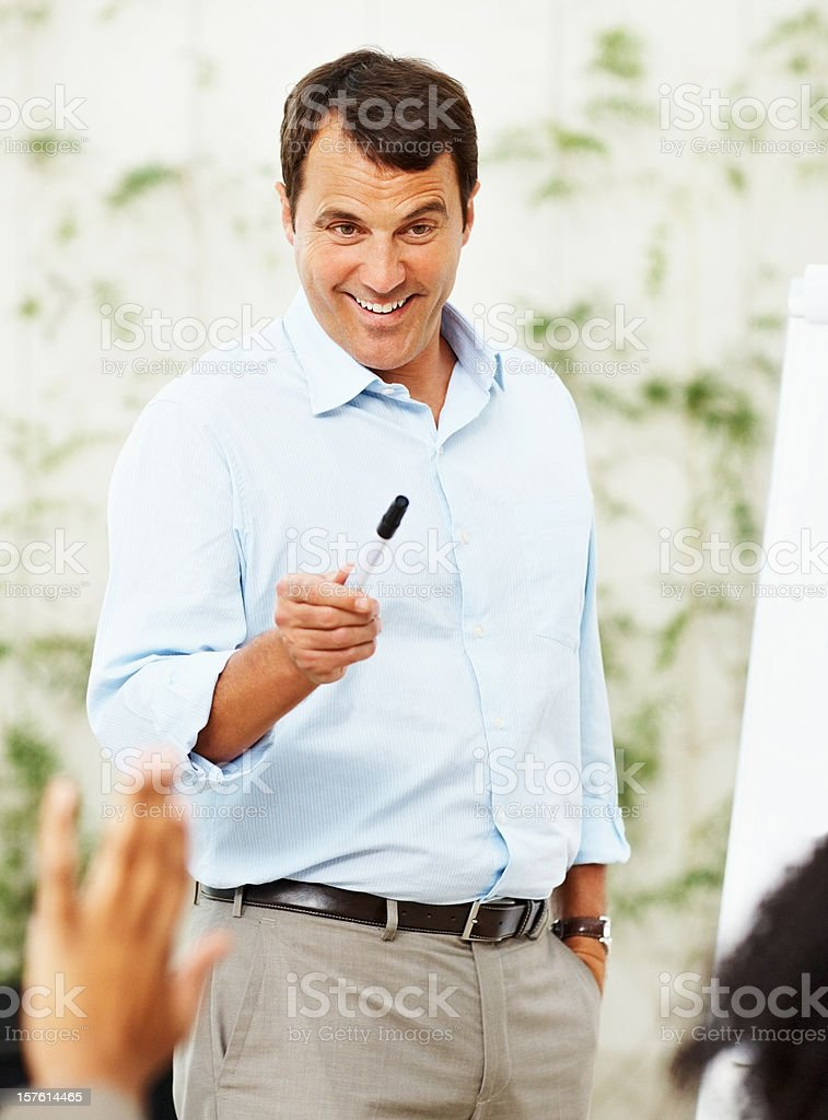 Successful happy business man training a team royalty-free stock photo