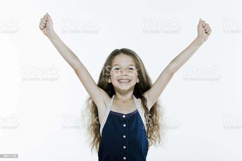successful happy little girl amrs raised royalty-free stock photo