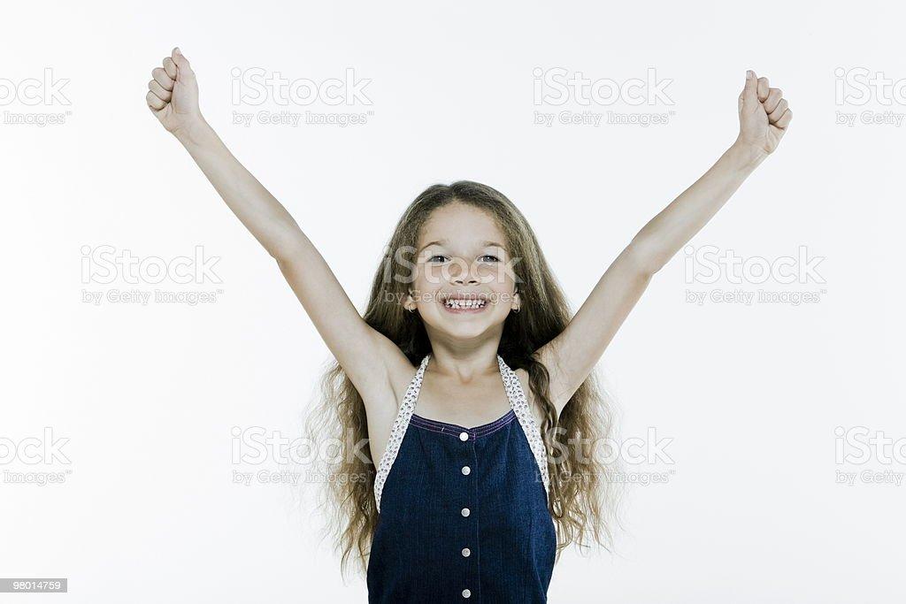 성공한 행복한 어린 소녀 amrs 돋아져 royalty-free 스톡 사진