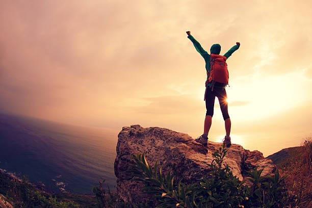 successful hiker hiking on seaside mountain peak – Foto