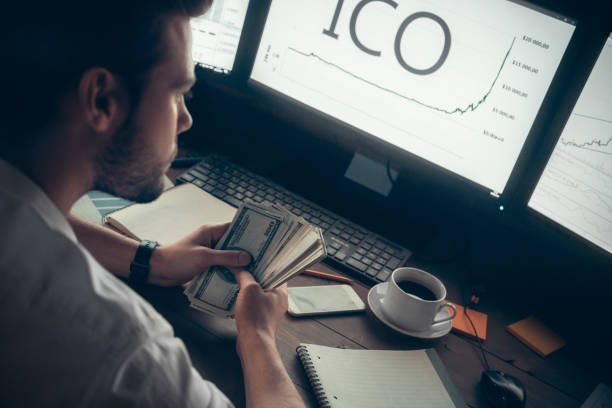 Successful investor holding cash making money from initial coin offering Successful investor holding cash making money with initial coin offering, rich stock trader broker earned high profit from cryptocurrency investment, token sale exchange and ico participation concept initial coin offering stock pictures, royalty-free photos & images