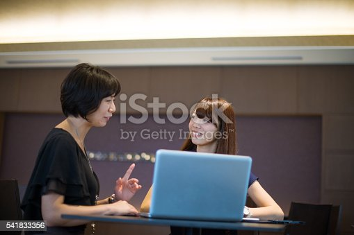 589445574istockphoto Successful Japanese female managers deciding on investment proposals. 541833356