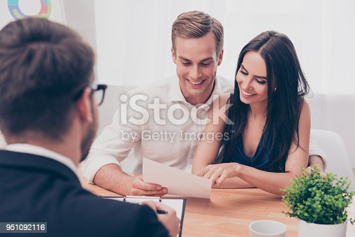 istock Successful lawyer giving consultation to family couple about buying house 951092116