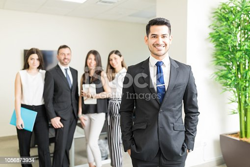 istock Successful Leader With Team In Background 1056873934