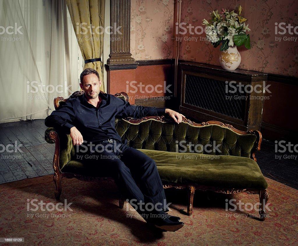 Successful Man, Dark, Luxurious Room stock photo