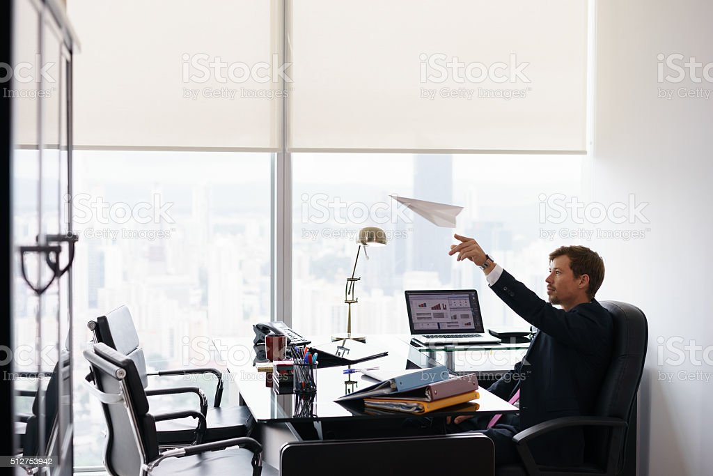 Successful Man Office Worker Daydreaming Throwing Paper Airplane stock photo