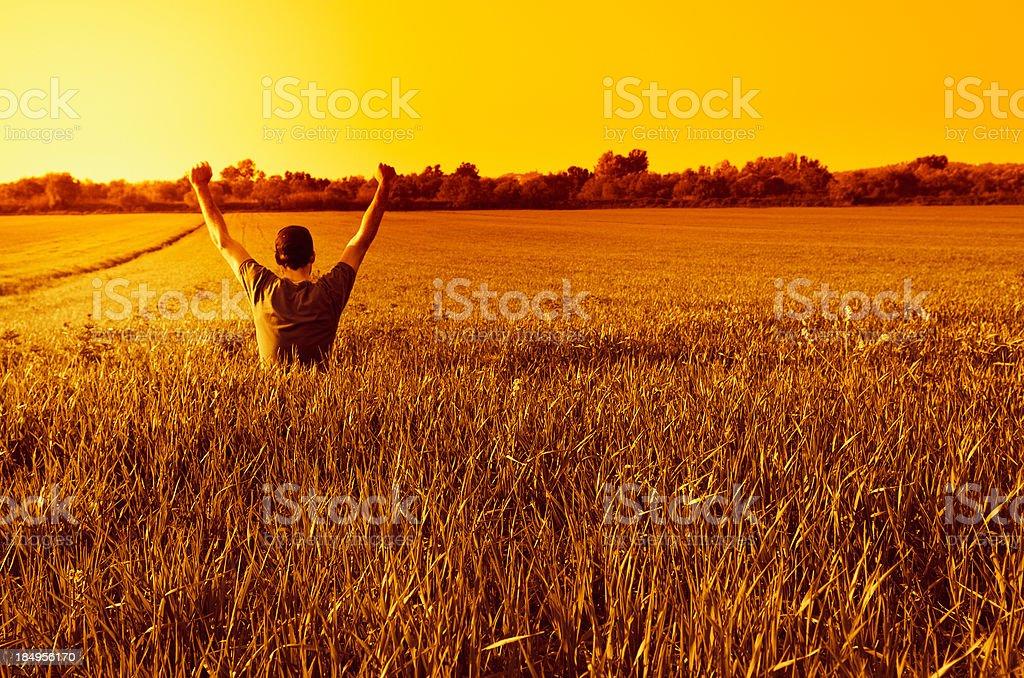 Successful man praying at sunset sunlight royalty-free stock photo