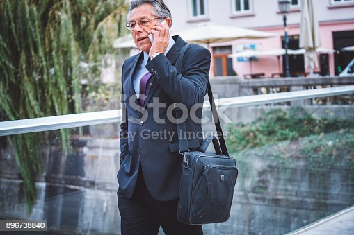 istock Successful man talking to his employees 896738840