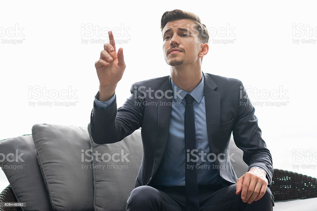 Successful Man Trying to Get Waiters Attention stock photo