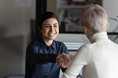 istock Successful manager making deal with partner shake hands express respect 1256907191