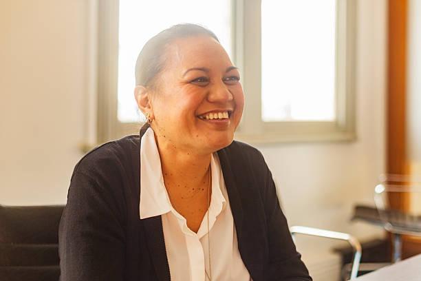 Successful Maori Pacific Islander Business Woman Leading a Team Meeting stock photo