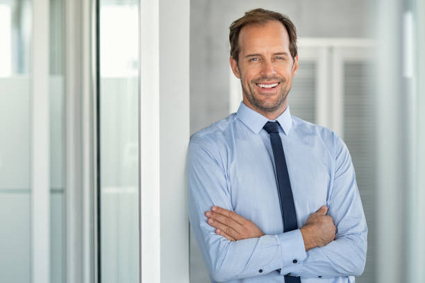 Successful mature business man in modern office stock photo