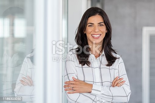 949435100 istock photo Successful mature business woman looking at camera 1189303232