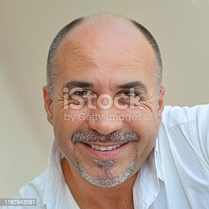 464621546 istock photo Successful Mature Man Smiling Looking at camera 1162943261