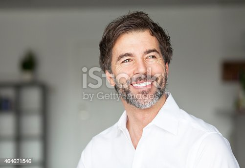 istock Successful Mature Man Smiling Looking Away 464621546