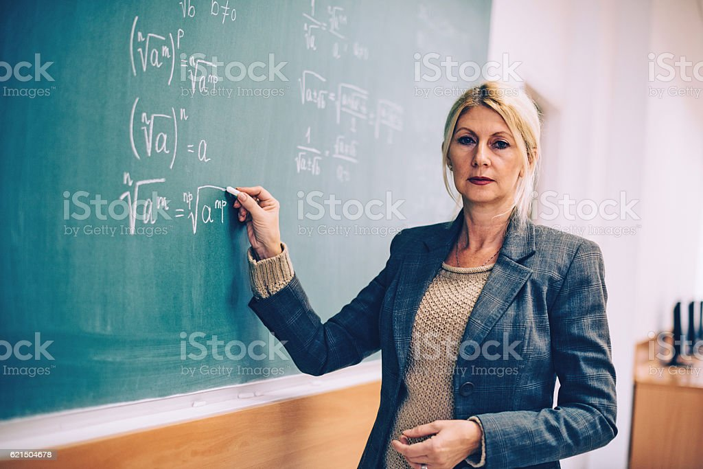 Successful mature math professor in classroom photo libre de droits