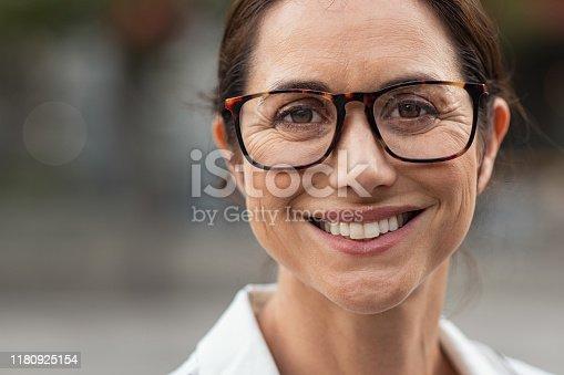 949435100 istock photo Successful mature woman wearing eyeglasses 1180925154