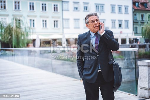 istock Successful middle age businessman arranging meetings on his phone 896735080