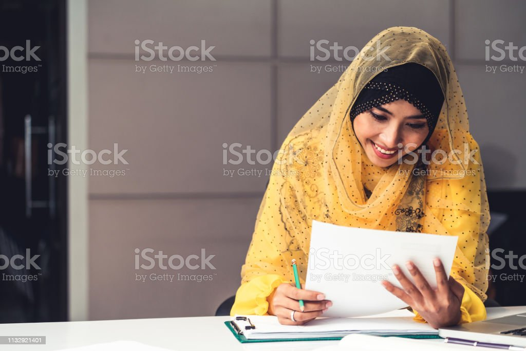 Successful Middle Eastern Muslim businesswoman working in office. International business success concept. stock photo
