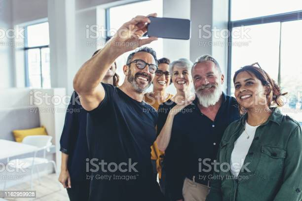 Successful multiracial business team taking selfie picture id1162959928?b=1&k=6&m=1162959928&s=612x612&h=sgvhjverafrgrppijs01gtn5cshyjkpdoivtkssnoeg=