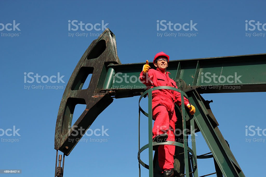 Successful Oil Worker at Work  Showing Thumbs Up stock photo