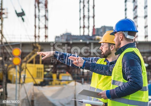 istock Successful people working on common project 628578920