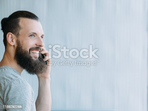 1161068403 istock photo successful professional career man talking phone 1159292268