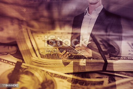 Businessman signing papers in concept of  successful profitable business