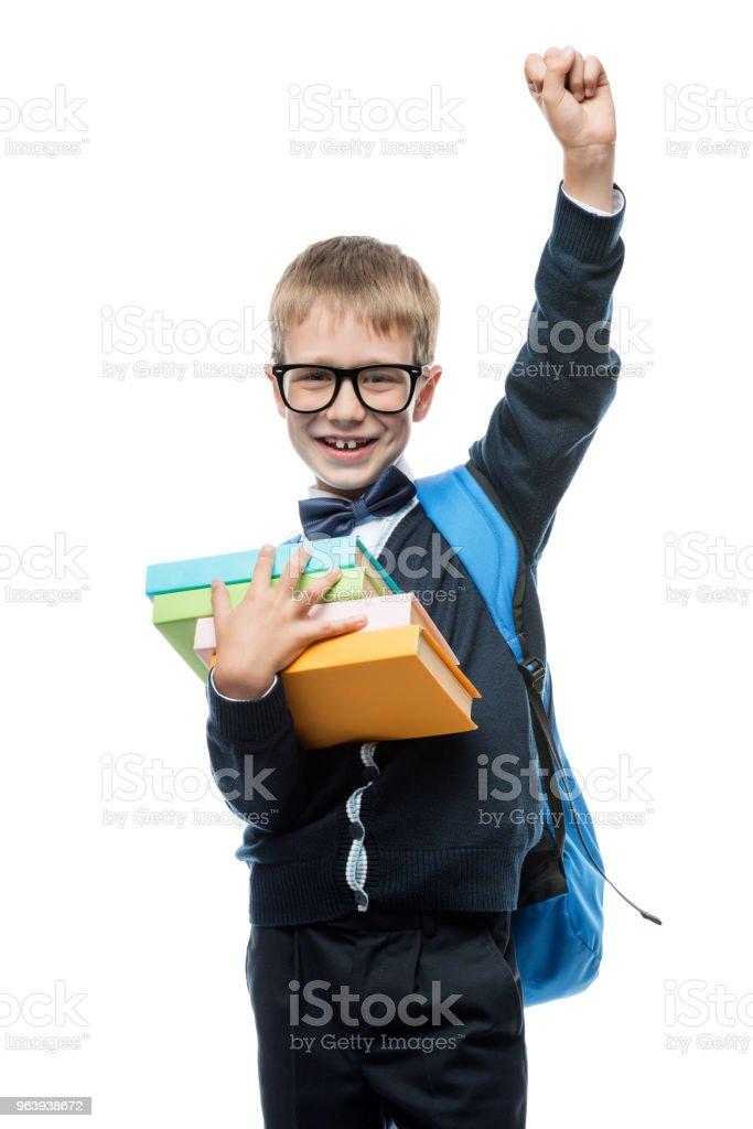 スタジオで白い背景の上の教科書の山とメガネをかけて成功した少年 - 1人のロイヤリティフリーストックフォト