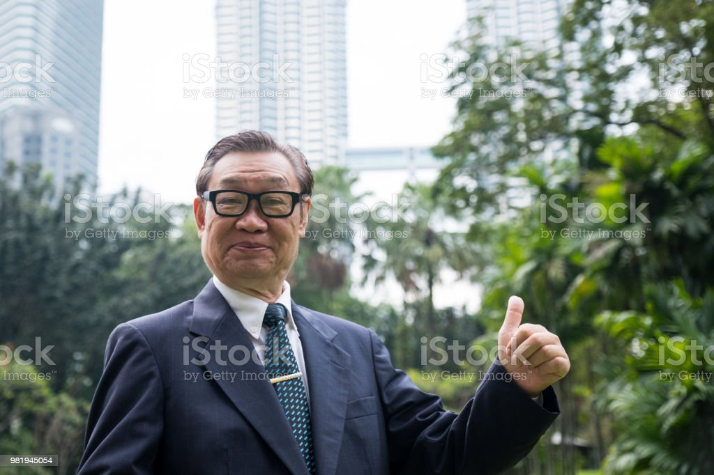 Successful senior Asian Businessman stock photo